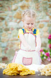 Girl smashing an egg into the flour for pasta. Royalty Free Stock Photography