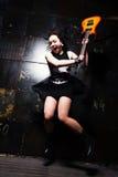 Girl Smashing Guitar Stock Photo