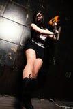 Girl Smashing Guitar Stock Image
