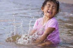 Girl is smashing water Royalty Free Stock Image