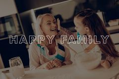 Girl Smeared Woman`s Nose. Happy Family Cooking. Girl Smeared Grandmother`s Nose. Happy Family Cooking. Happy Family Have Fan. Grandmother Help Girl. Little stock images