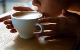 Girl smell aroma coffee cup. perfect morning with best coffee. fresh morning coffee with milk and cream froth. relax in stock image