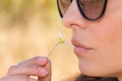 Girl smell flower Stock Image