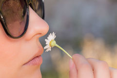 Girl smell flower Stock Photos