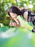 A girl smell the flower Royalty Free Stock Photos