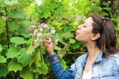 Girl smell a Flower Stock Images