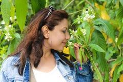 Girl smell a Flower Stock Photos