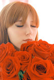 Girl smell flowers Stock Photography