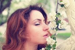 Girl smell tree flower Royalty Free Stock Image