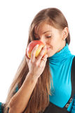 Girl smelling an apple Stock Photo