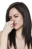 Girl smelling a bad odor profile Stock Photography