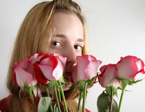 Girl smelling bunch of roses Stock Photography