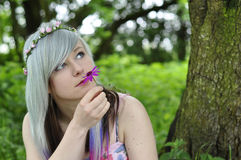 Girl smelling Flower. An image of a beautiful teenage girl smelling a pink flower Stock Photography