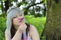 Girl smelling Flower. An image of a beautiful teenage girl smelling a pink flower Royalty Free Stock Photo