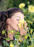 Girl smelling a flower Royalty Free Stock Images