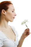 Girl smelling a flower Royalty Free Stock Photography
