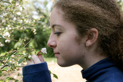 Girl Smelling a Flower Royalty Free Stock Photo