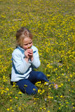 Girl smelling flower Stock Photo