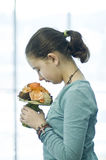 Girl smelling flower bouquet Stock Photography
