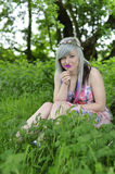 Girl smelling Flower in forest. An image of a beautiful teenage girl smelling a pink flower Stock Images