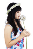 Girl is smelling a flower stock images