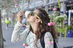 Girl smelling flower in the romantic garden. With bokehlicious background stock photos