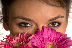 Girl smelling flowers Stock Photo