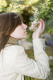 Girl smelling flowers. Girl smelling jasmine flowers in a beautiful garden Stock Photography