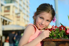 Girl smelling flowers Stock Images