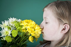 Girl smelling flowers Royalty Free Stock Photos