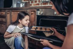 Girl smelling fresh backed cookies stock images