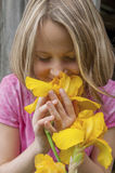 Girl smelling Iris flowers Stock Photo