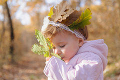 Girl Smelling Leaf Stock Photos