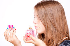 Girl smelling perfume Royalty Free Stock Image