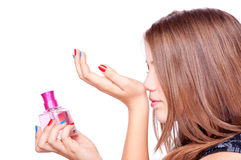 Girl smelling perfume Royalty Free Stock Photo