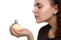 Girl is smelling the perfumes Stock Photography