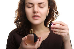 Girl is smelling the perfumes Stock Images