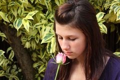 Girl smelling rose Royalty Free Stock Photo