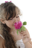 Girl smelling rose Stock Image