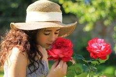 Girl smelling roses Royalty Free Stock Photo
