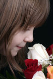 Girl smelling roses Royalty Free Stock Images