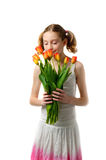 Girl smelling tulips Royalty Free Stock Photo