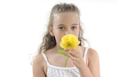 Girl smelling yellow rose Royalty Free Stock Image