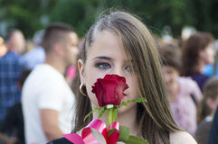 Girl smells a rose Stock Photo