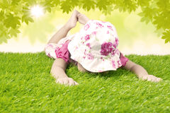 Girl smells spring grass Stock Images