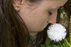Girl smells white flower. S in the garden Stock Images