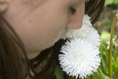 Girl smells white flower. S in the garden Royalty Free Stock Photo