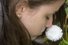 Girl smells white flower. S in the garden Royalty Free Stock Photos