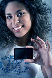 Girl with a smile. Girl with a beautiful smile and music player stock photo