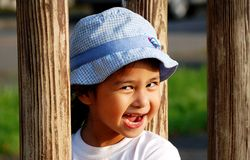 Girl smile. A Girl wearing hat smiles when playing Stock Photo
